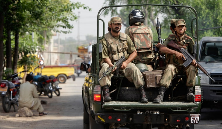 Image: Pakistan army soldiers patrol around the vicinity of the army intelligence office in Peshawar, Pakistan