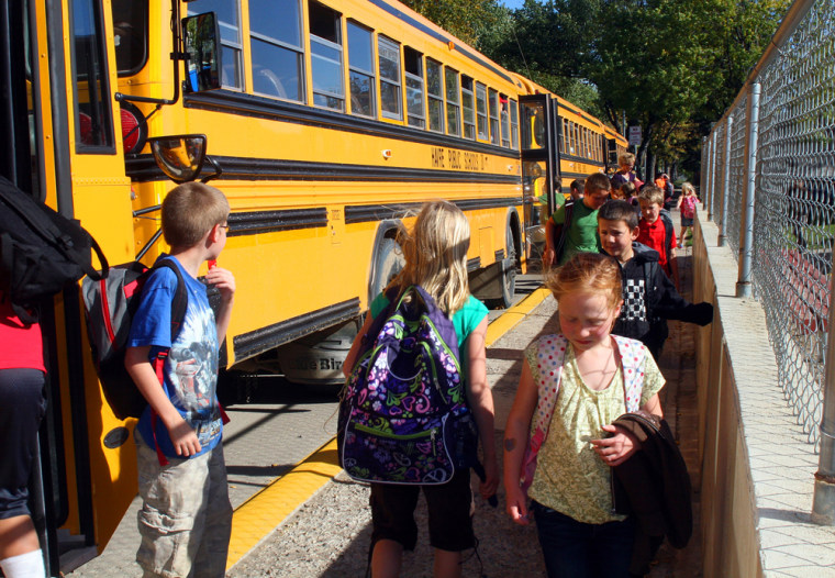 Students leave buses at Lincoln-McKinley Primary School in Havre, Mont., where classes are held year-round.