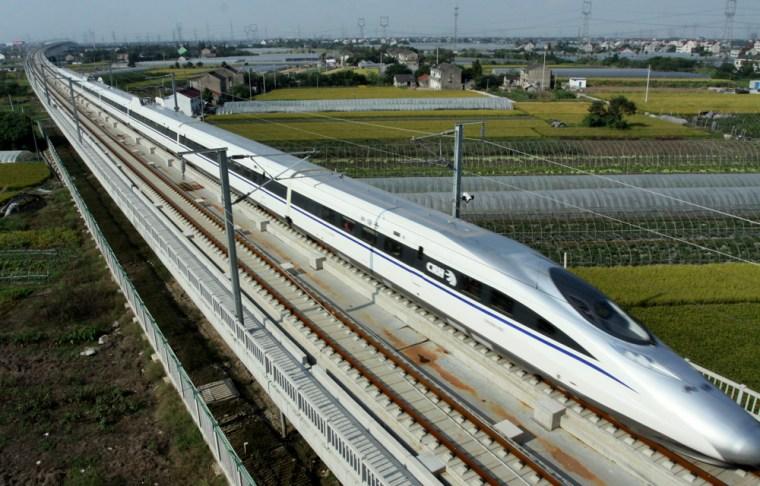"""Image: A """"CRH380A"""" train runs in Shanghai-Hangzhou high-speed railway"""