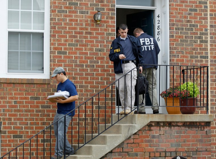 Image: FBI Investigators leave the home of Farooque Ahmed in Ashburn, Va.