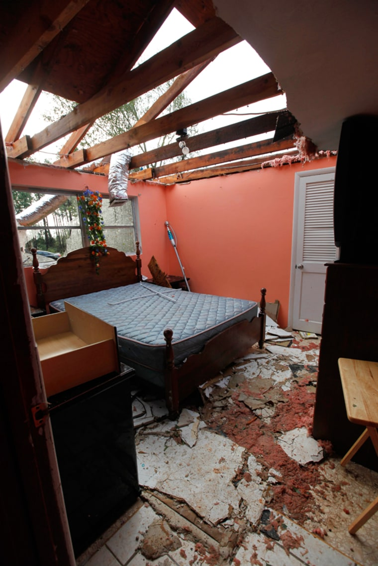Image: Pieces of the roof and ceiling lay on the floor of a bedroom in a damaged home in Vale, N.C.