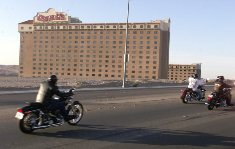 Image: Motorcyclists drive past Harrah's casino