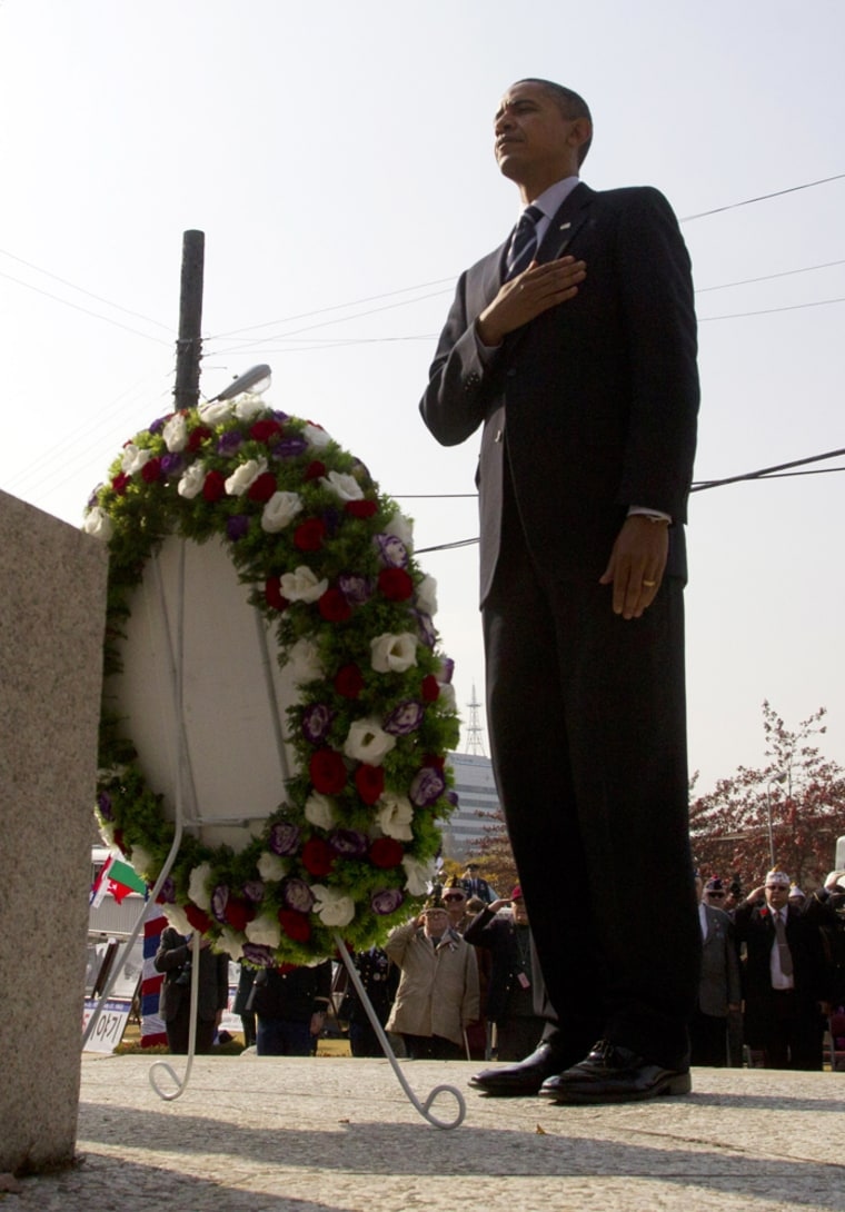 Image: President Barack Obama lays a wreath at a war memorial on Veterans Day during his visit to the U.S. Army Garrison in Seoul
