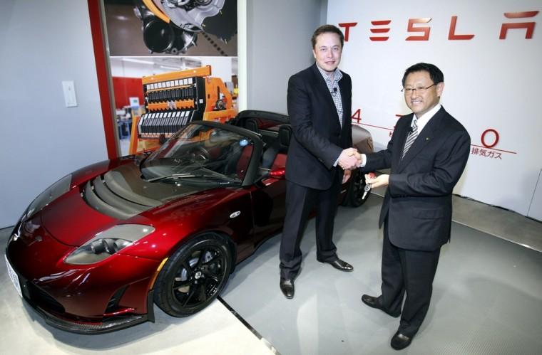 Image: Akio Toyoda, Elon Musk