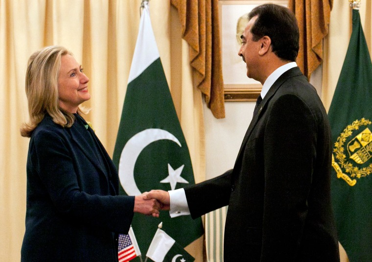 Image: Pakistan's PM Gilan greets U.S. Secretary of State Clinton at the prime minister's residence in Islamabad