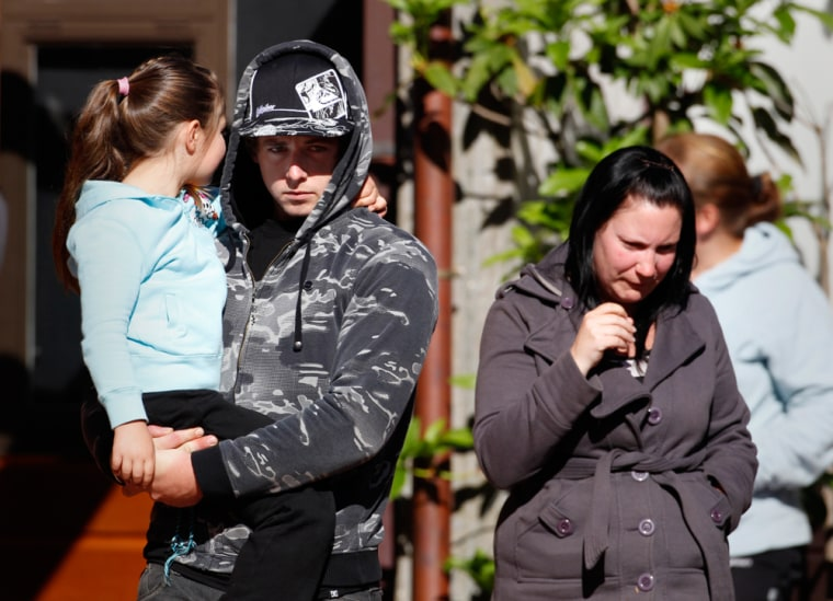 Image: Family members of miners trapped underground in the Pike River coal mine leave a progress briefing by mine authorities and police in Greymouth