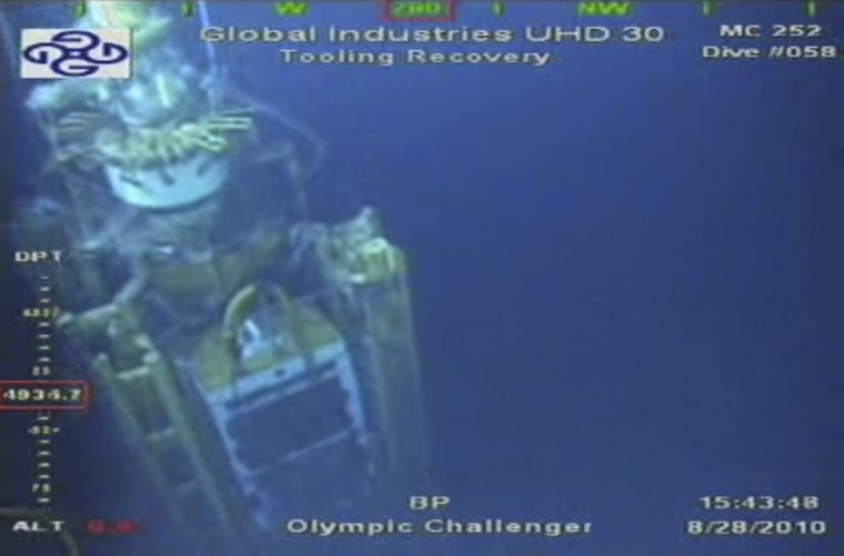 Image: Video grab of the containment capping stack as work continues at the site of the BP oil well leak in the Gulf of Mexico