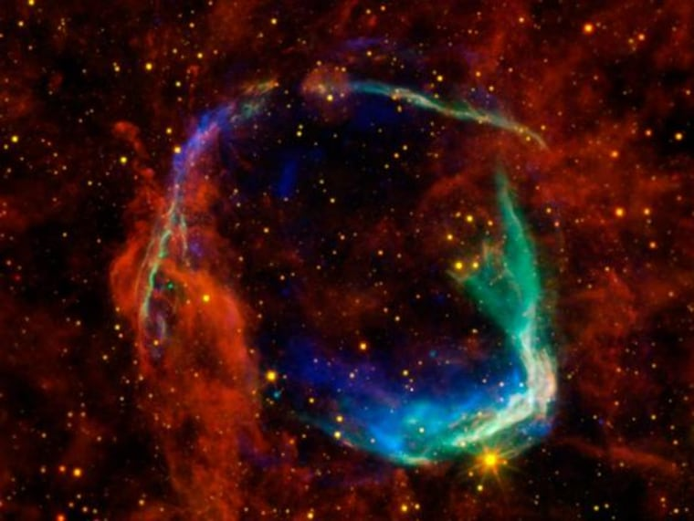 """This image combines data from four different space telescopes to create a multi-wavelength view of all that remains of the oldest documented example of a supernova, called RCW 86. The Chinese witnessed the event in 185 A.D., documenting a mysterious """"guest star"""" that remained in the sky for eight months."""