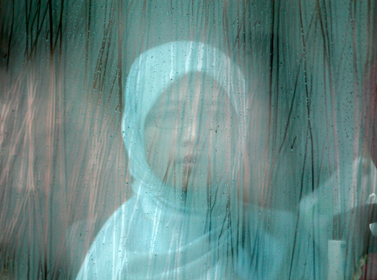 Image: A Malay woman sits in a bus in Putrajaya