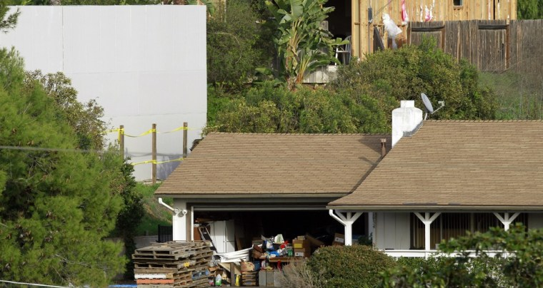 Image: A view of a containment wall built by the San Diego County Sheriff's Department in Escondido