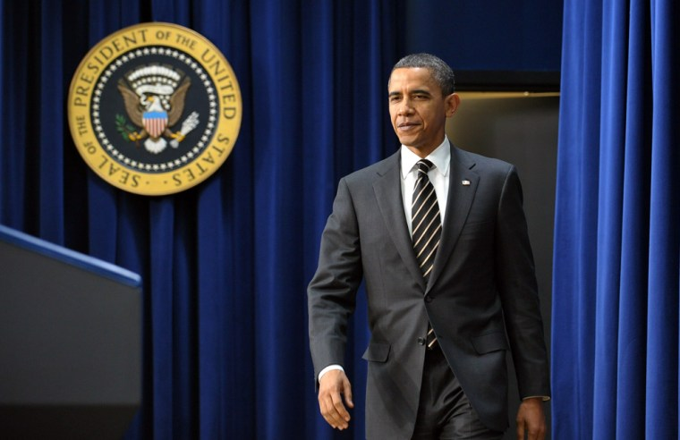 Image: US President Barack Obama makes his way