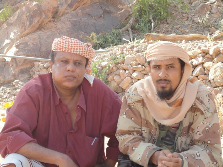 Fahd al Quso, right, indicted in the Oct. 12, 2000, bombing of the destroyer USS Cole poses with Yemeni journalist Arafat Mudabish in a mountainous area of Yemen, where he reportedly is being protected by tribesmen.
