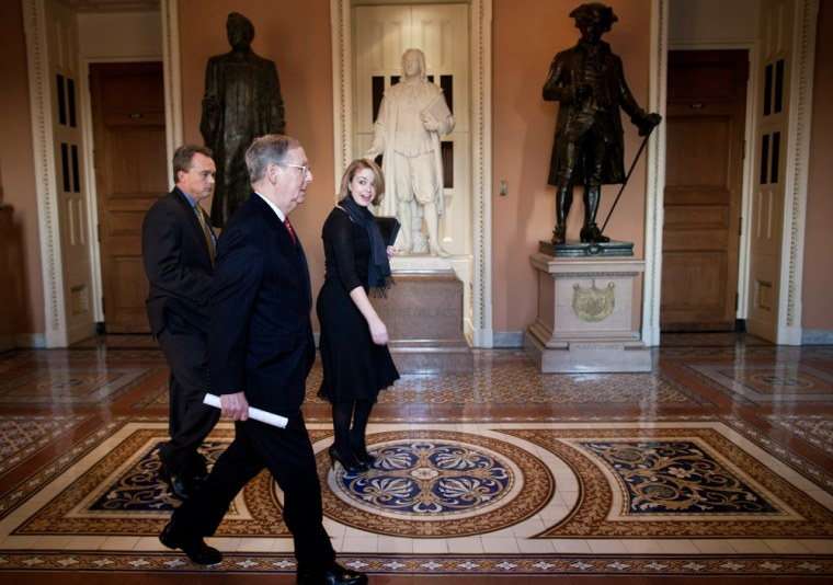 Image: U.S. Sen. Minority Leader Mitch McConnell (R-KY) walks from the Senate floor to his office on Capitol Hill