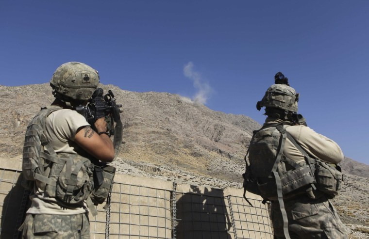 Image: U.S. troops return fire as smoke rises from Taliban position