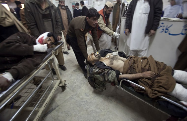 Image: Men injured in a suicide bomb attack in Pakistan's northwest Bajaur region are brought to Lady Reading Hospital in Peshawar for treatment