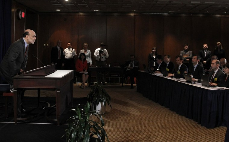 Image: U.S. Federal Reserve chief Ben Bernanke takes his seat at the beginning of a news conference in Washington