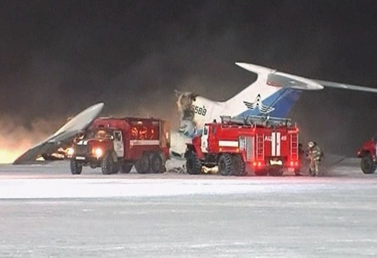 Image: Video grab of fire fighting vehicles parking near a Tupolev-154 passenger plane that caught fire and blew up in Surgut Airport