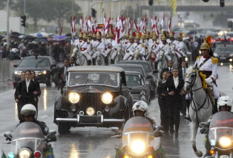 Image: Brazil's President-elect Dilma Rousseff is driven to Congress where she will be sworn in to succeed Luiz Inacio Lula da Silva in Brasilia