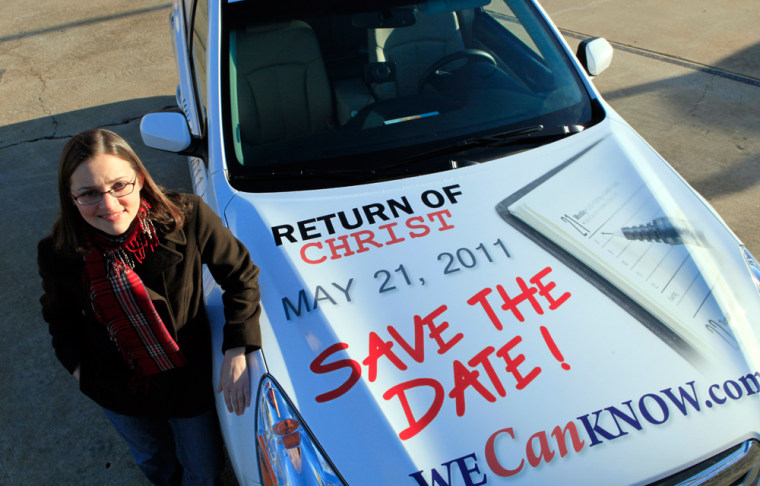Image: Allison Warden poses with her car showing a message about the rapture.