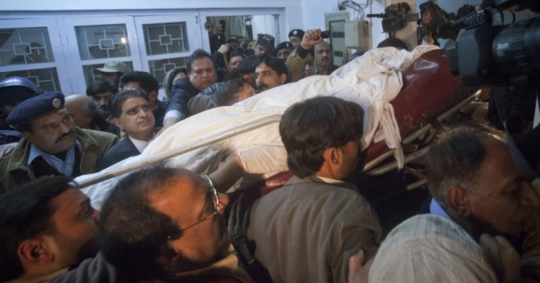 Image: Body of the governor of Punjab province Taseer is carried out of a hospital in Islamabad