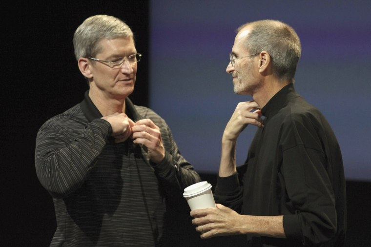 Image: Apple COO Tim Cook and CEO Steve Jobs  at news conference at Apple headquarters in Cupertino