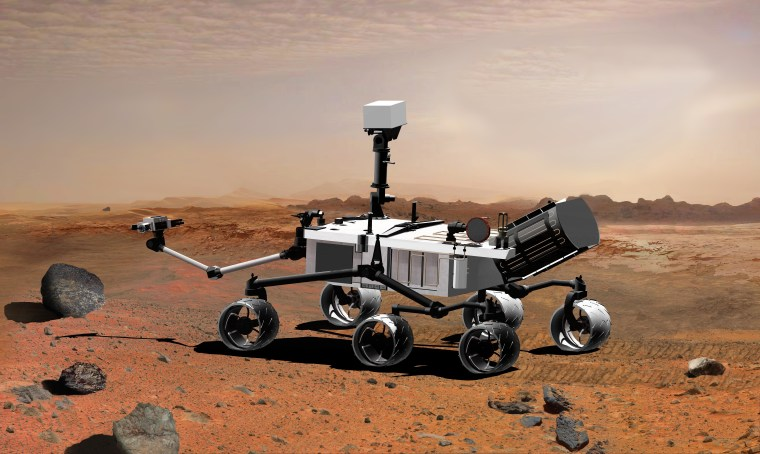 An artist's concept illustrates the Mars rover Curiosity on the Red Planet. NASA said Friday a planned 3-D camera won't be aboard the flight, and that the current camera meets mission goals.