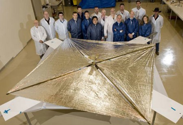 The Huntsville-based NanoSail-D team stands with the fully deployed sail at ManTech SRS technologies on April 16, 2008, aftera successful deployment test.