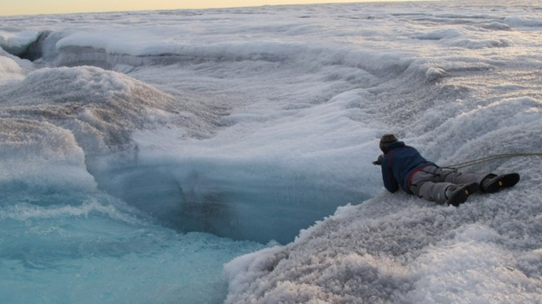 Image: Meltwater flows into Greenland ice