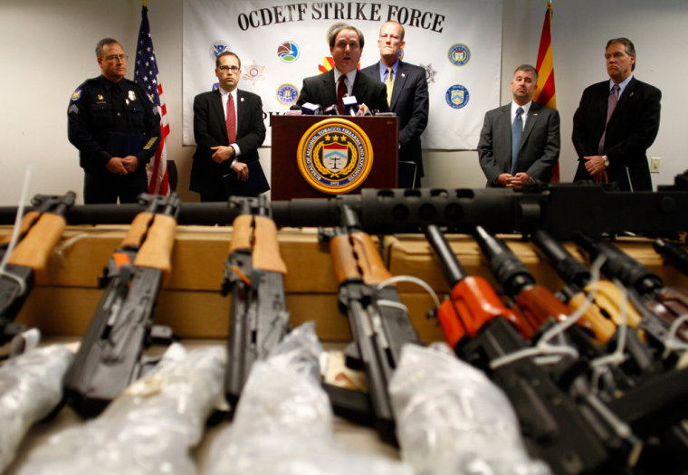 Image: District of Arizona United States Attorney Dennis Burke \speaks about recovering weapons from defendants accused of trafficking illegal firearms to Mexican drug cartels during a news conference in Phoenix
