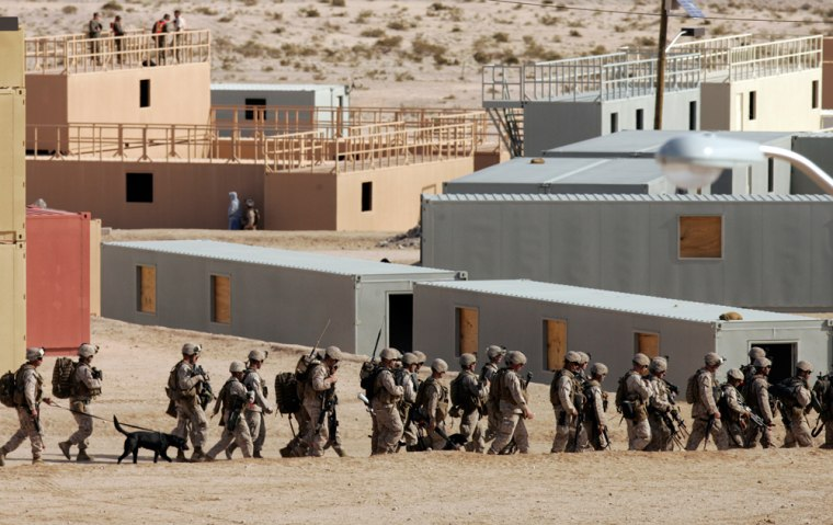 Image: Marines training in a mock city built at Twentynine Palms, Calif.
