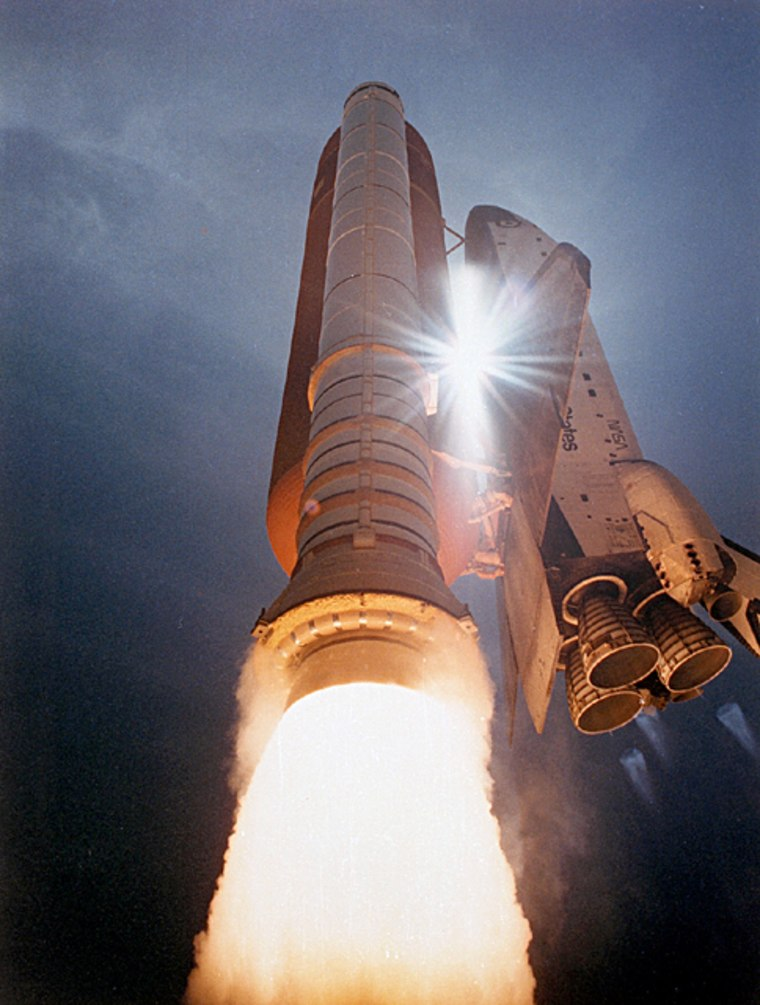A space shuttle blasts into the sky during alaunch from NASA's Kennedy Space Center in Florida.