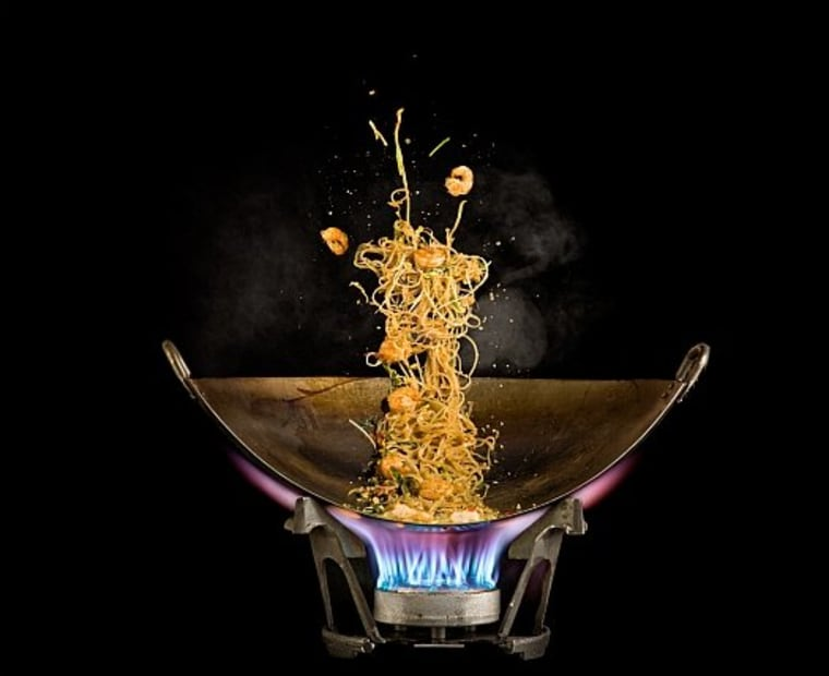 Hot Pad Thai comes to life in a wok in the kitchen of Modernist Cuisine, an ambitious cookbook project. The self-published book will be sold in an acrylic case for $625.