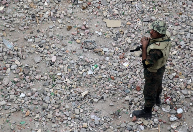Image: Egyptian soldier on stones in Tahrir Square in Cairo