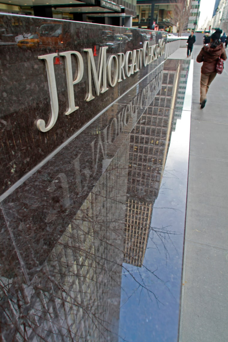 Image: JP Morgan Chase building reflects in its granite sign wall