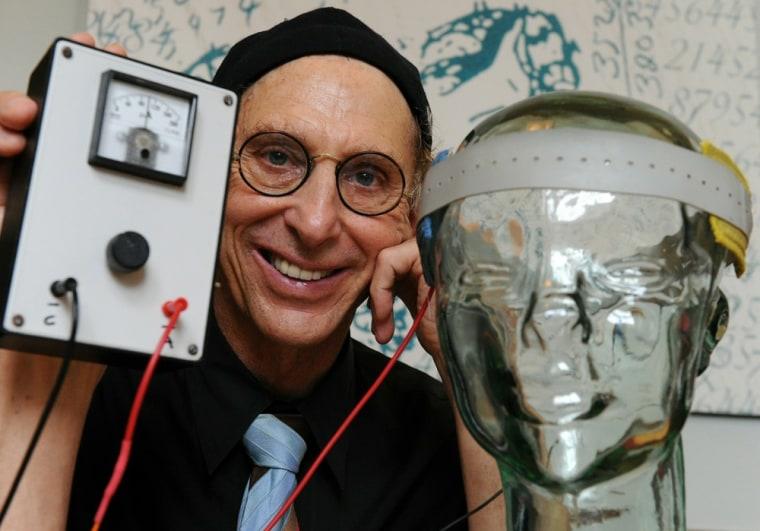 "Image: Professor Allan Snyder displays a ""think"