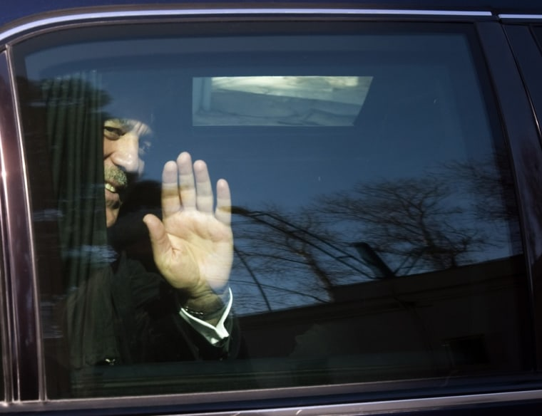 Image: Turkey's President Abdullah Gul waves to the media while leaving a presidential building after an official farewell ceremony in Tehran
