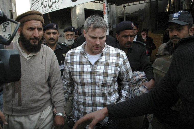 Image: Pakistani security officials escort Raymond Allen Davis, a U.S., center, to a local court in Lahore, Pakistan in January