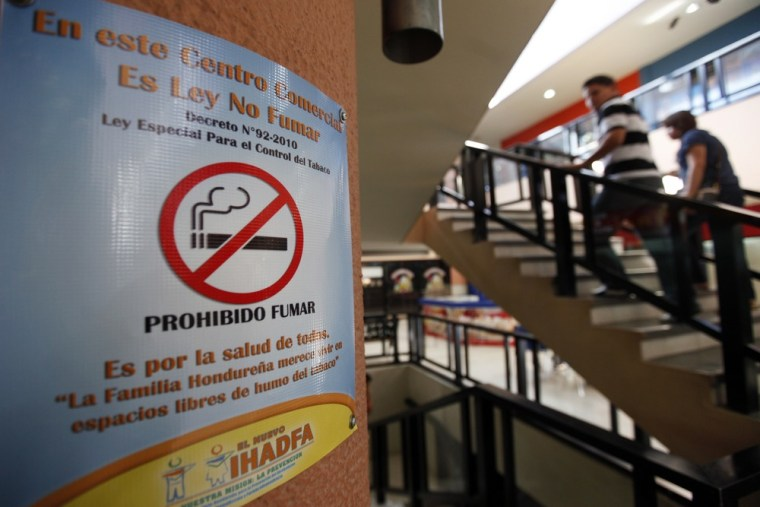"""Image: A """"No Smoking"""" sign is seen at a shopping center in Tegucigalpa"""