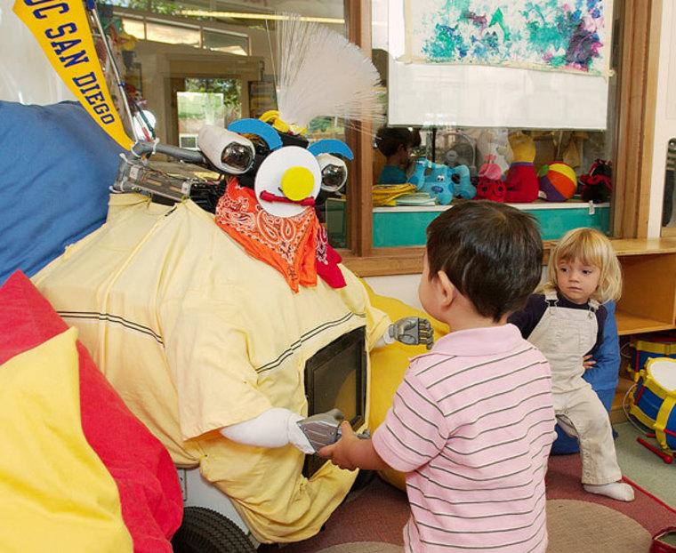 Image: RUBI robot with kids