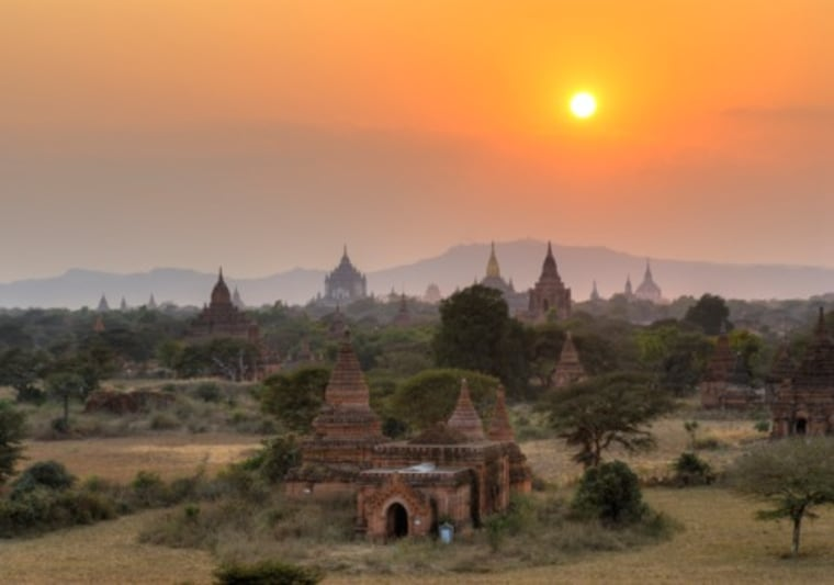 """InMyanmar, Bagan is an ancient city of temples spread out across a plain.Robert Reid of Lonely Planet says: """"You can go in with a flashlight and find a stairway up to the top of a temple and pick your spot for sunset. There is a big plain dotted with these huge, ancient temples everywhere, and you all sit and watch the sunset — it's absolutely beautiful."""""""