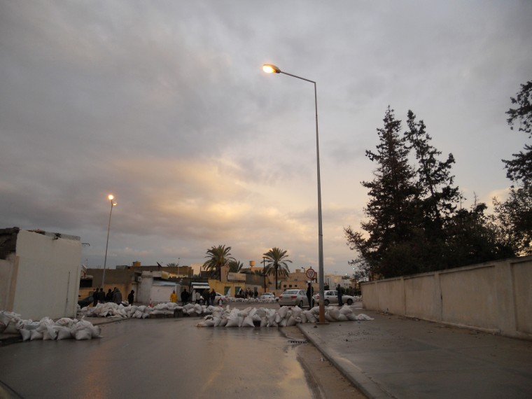 A common street scene in Misurata, with sandbag barricades and armed local residents standing guard