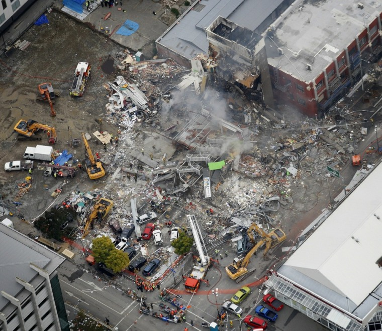 Image: An aerial view shows rescuers working at the ruined CTV building  in Christchurch