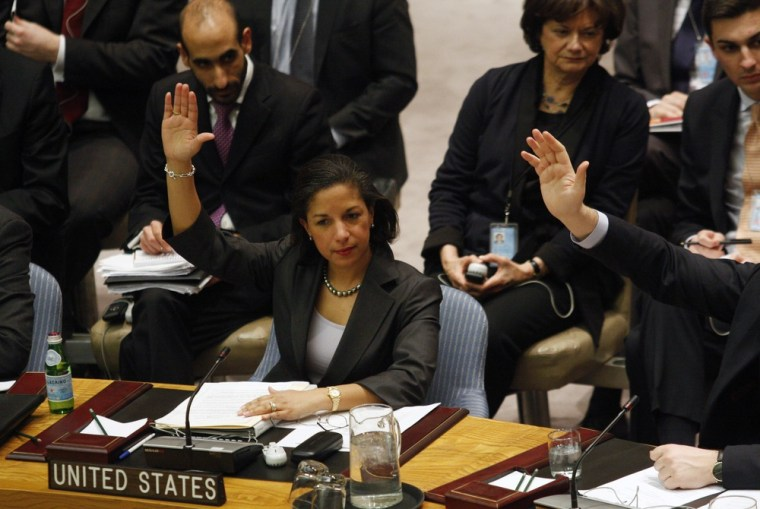 Image: U.S. Ambassador to the U.N. Rice raises her hand as she votes on a resolution during a Security Council meeting at U.N. headquarters in New York
