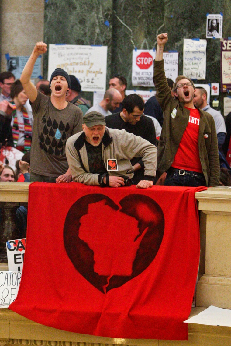 Image: Protesters demonstrate at the state Capitol in Madison