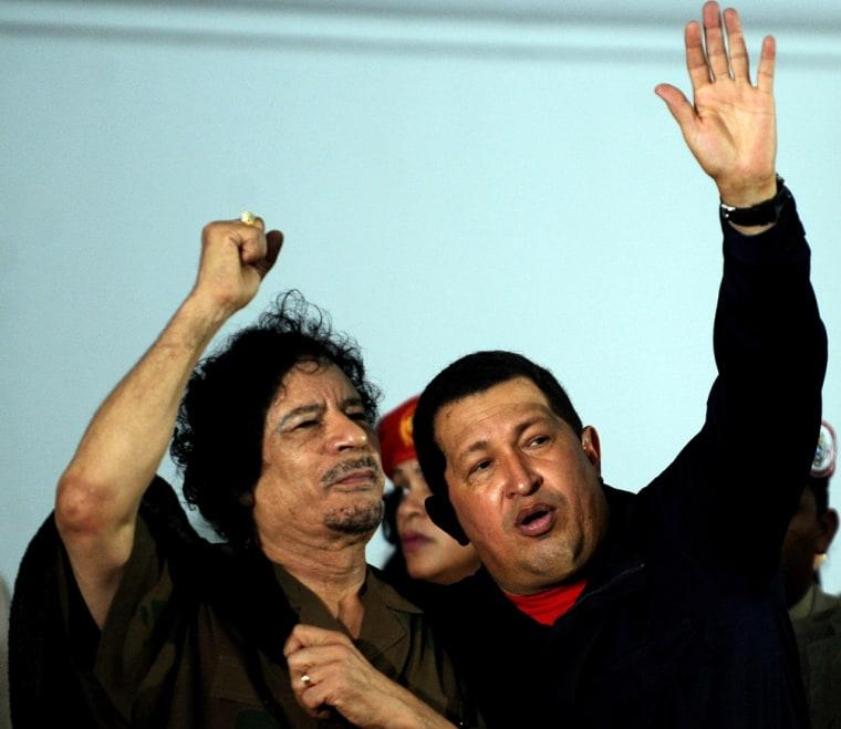Image: Libyan leader Moammar Gadhafi and Venezuelan President Hugo Chavez at a meeting in 2009