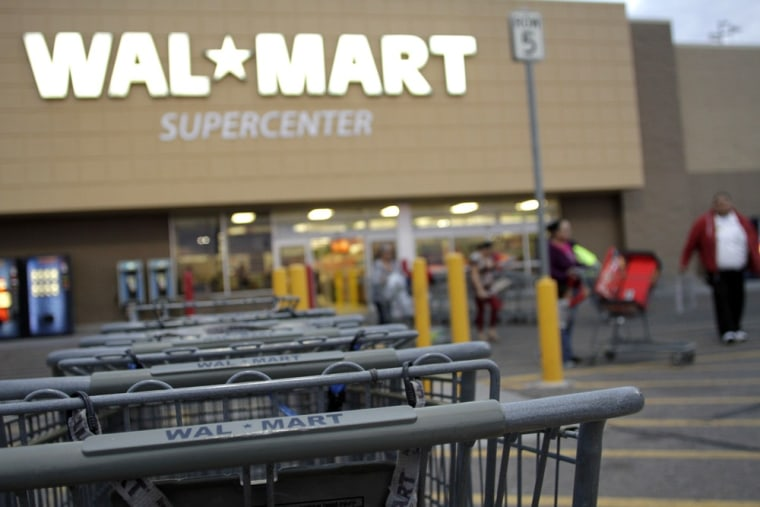 Image: Shopping carts are seen outside a Wal-Mart Supercenter in Coolidge