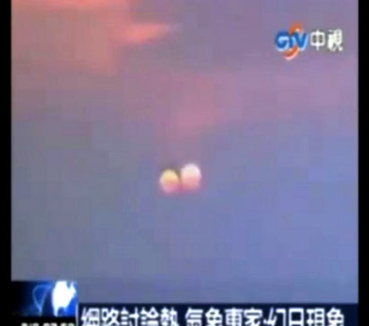 """A still from a video that purportedly shows """"two suns"""" setting in China. One scientist suspects the apparition could be an optical illusion at sunset, rather than an all-out hoax."""
