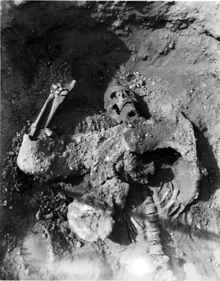 The skeleton of a Persian soldier found in the siege tunnels of Dura. The man may have choked on toxic fumes from a fire he himself started. The man's armor is pulled up around his chest; archaeologists suspect he was trying to pull it off as he died.