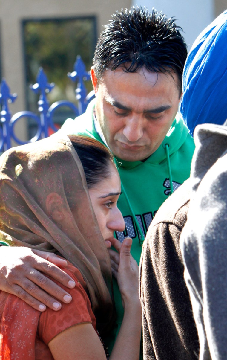 Image: Harvinder Singh comforts his daughter, Navi Kaur, during a news conference discussing the murder of his father, Surinder Singh