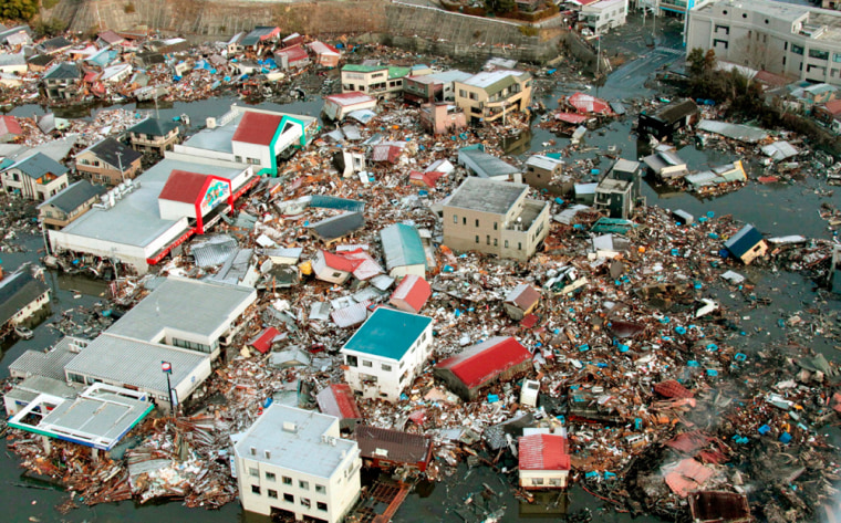 Image: Buildings tossed together by the tsunami is seen in Miyagi Prefecture
